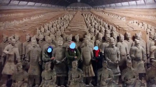 posing with terracotta warrior